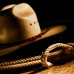 close up of cowboy hat and lasso