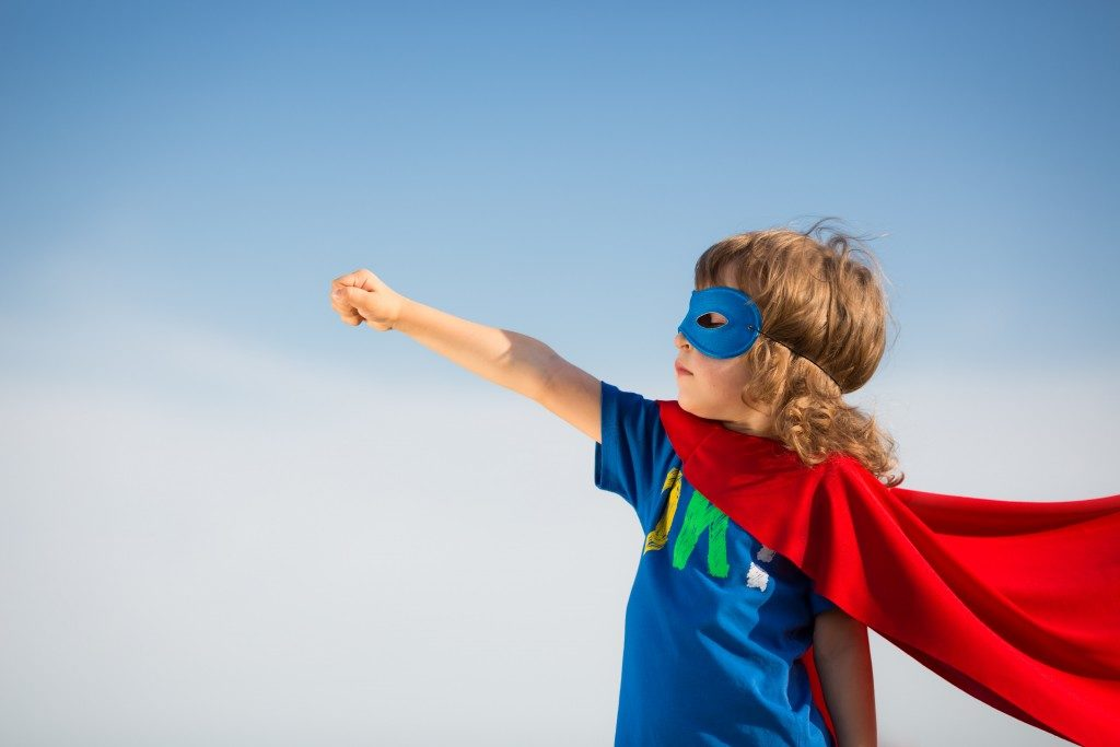 Kid dressed as a superhero