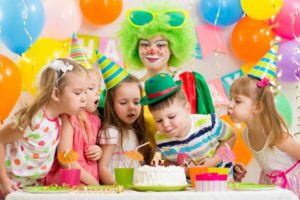 Kids blowing a birthday candle