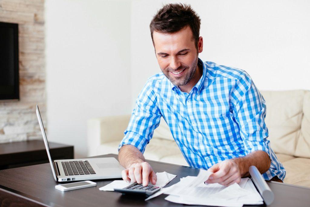 Man in plaid budgeting