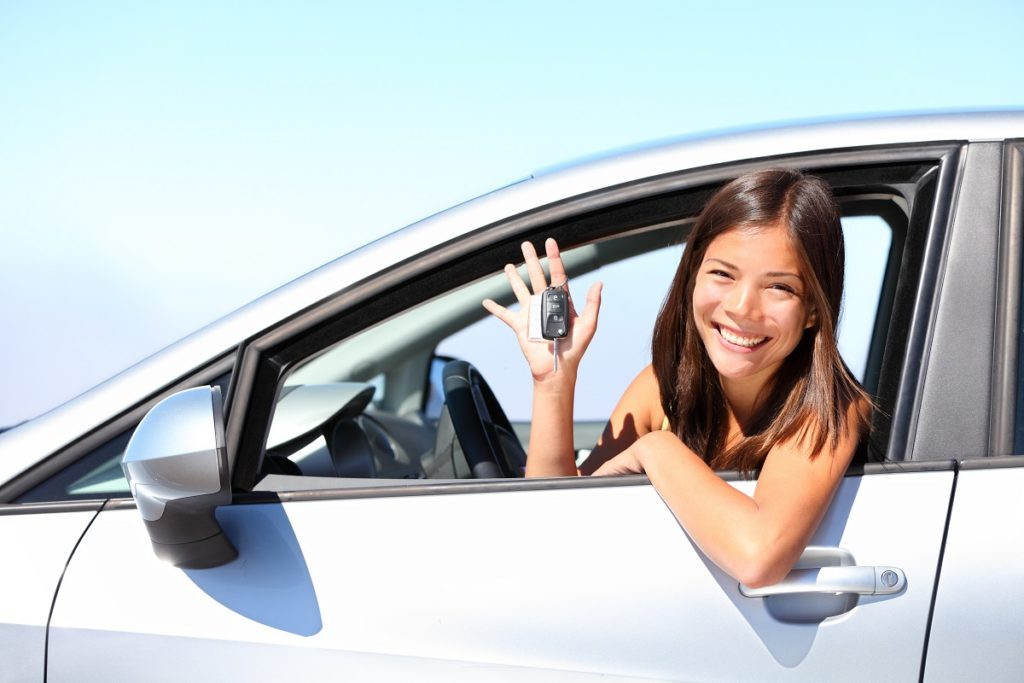 Woman showing her car key