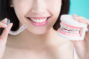 woman holding braces