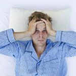 man having difficulties sleeping
