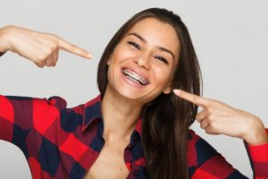 Woman pointing at her braces