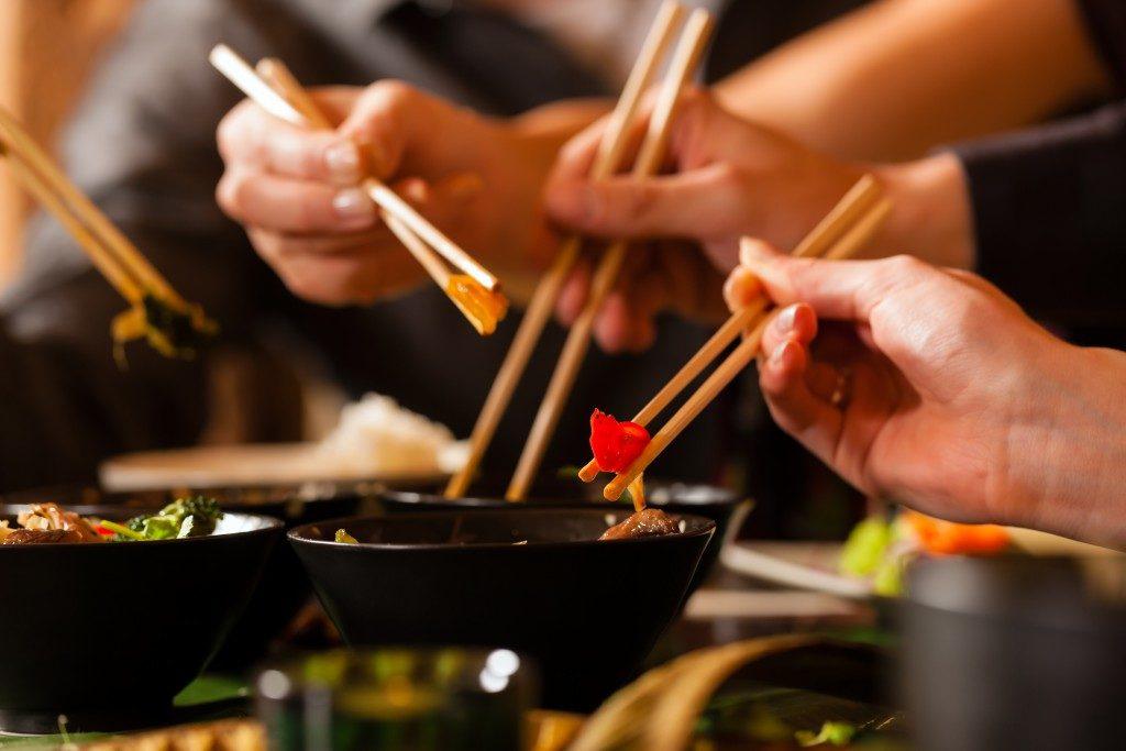 Hands holding chopsticks
