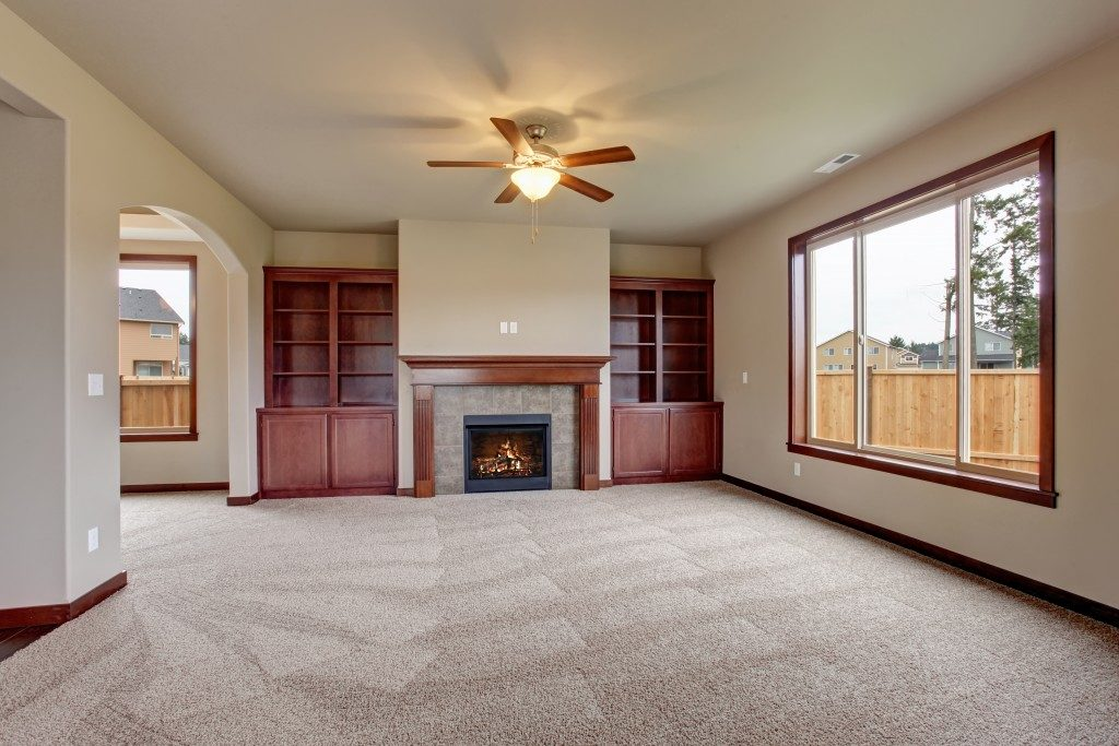 Unfurnished living room with a wide window