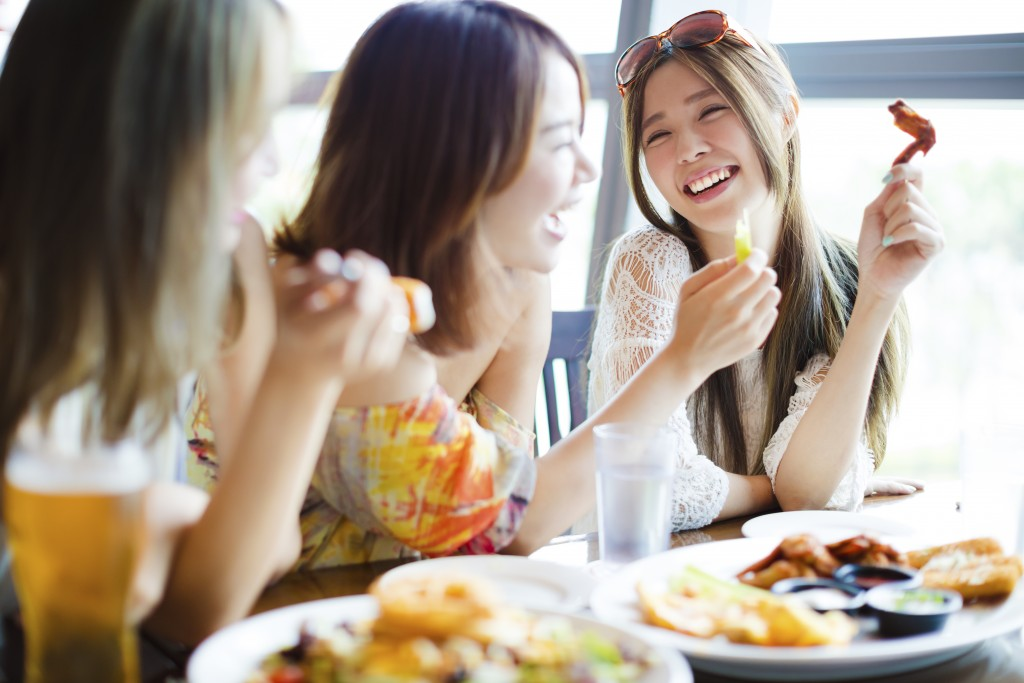 Group of friends laughing at a restaurant