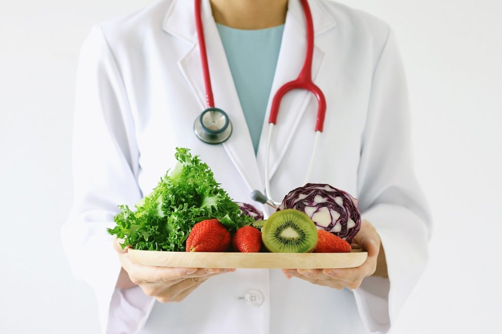 Doctor holding a tray of healthy food
