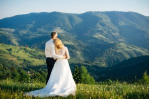 Young love couple celebrating a wedding in the mountains