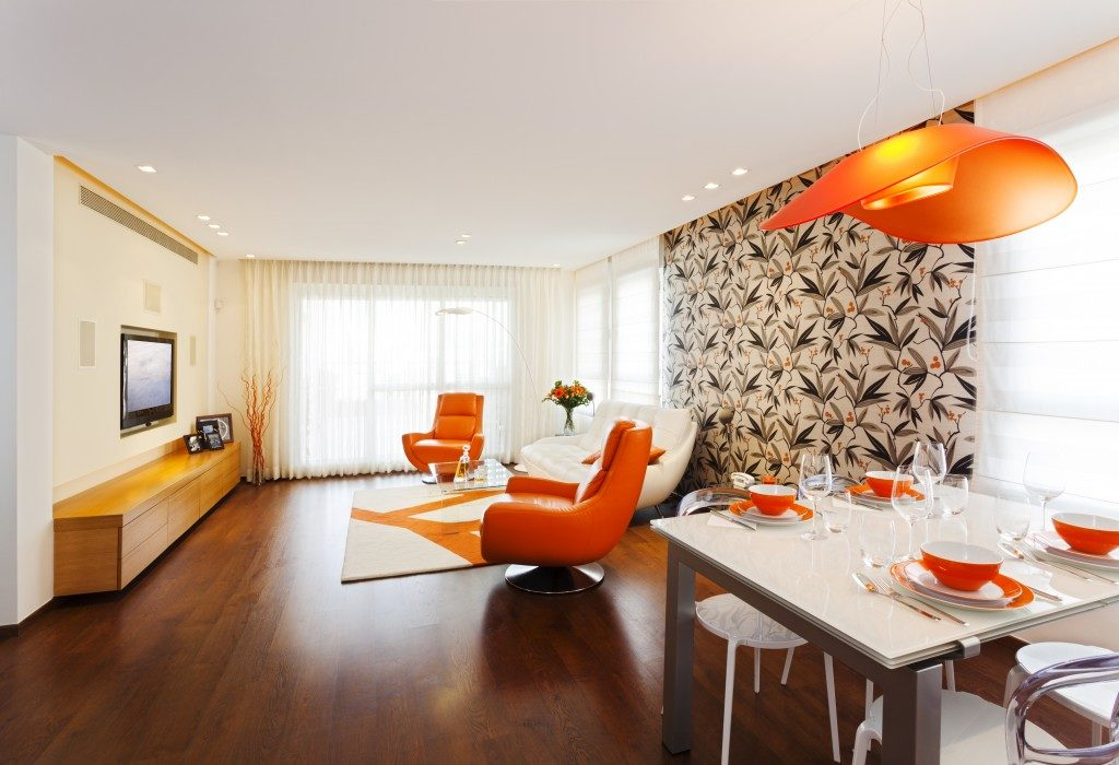 a studio apartment in wood flooring and orange texture