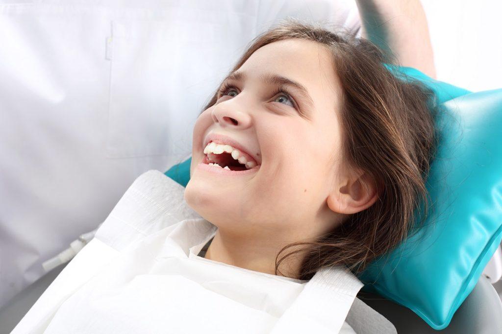 little girl in dentist
