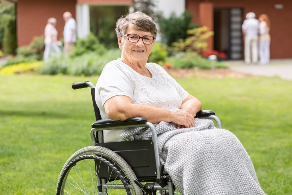 smiling old woman on a wheelchair