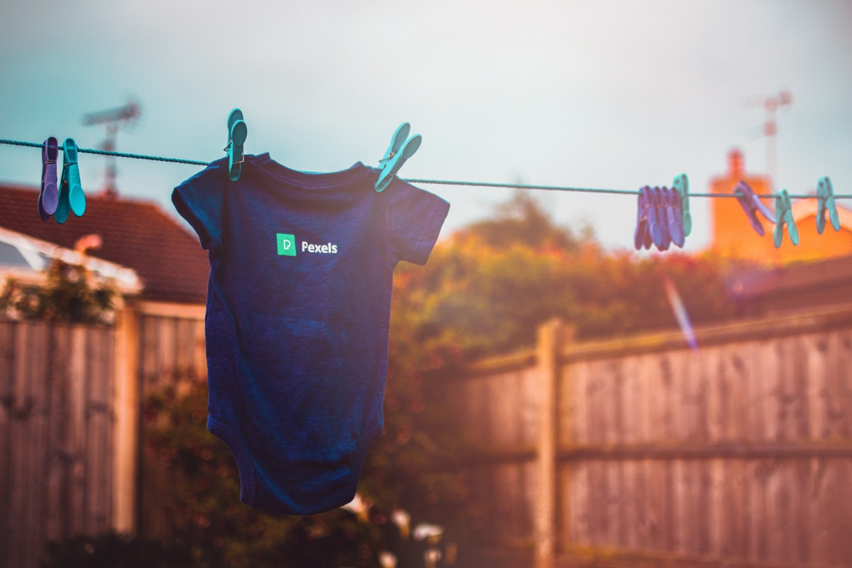 old baby clothes hanging outside to dry
