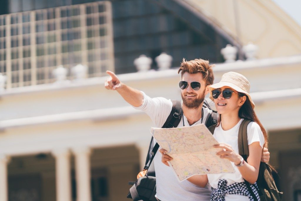 couple tourist using a map