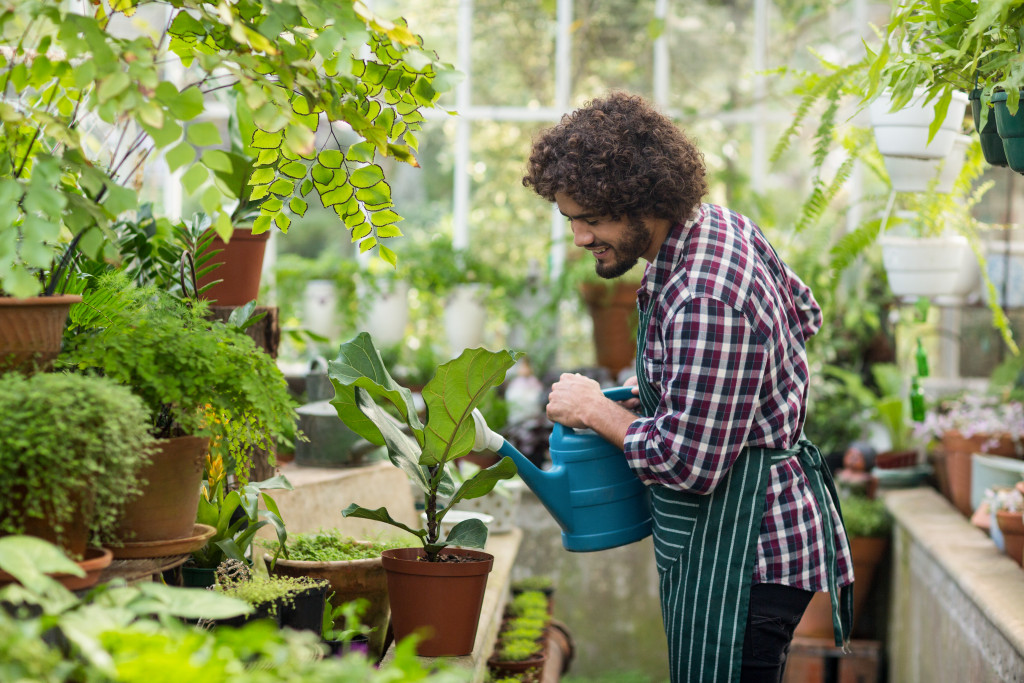 Male watering plants