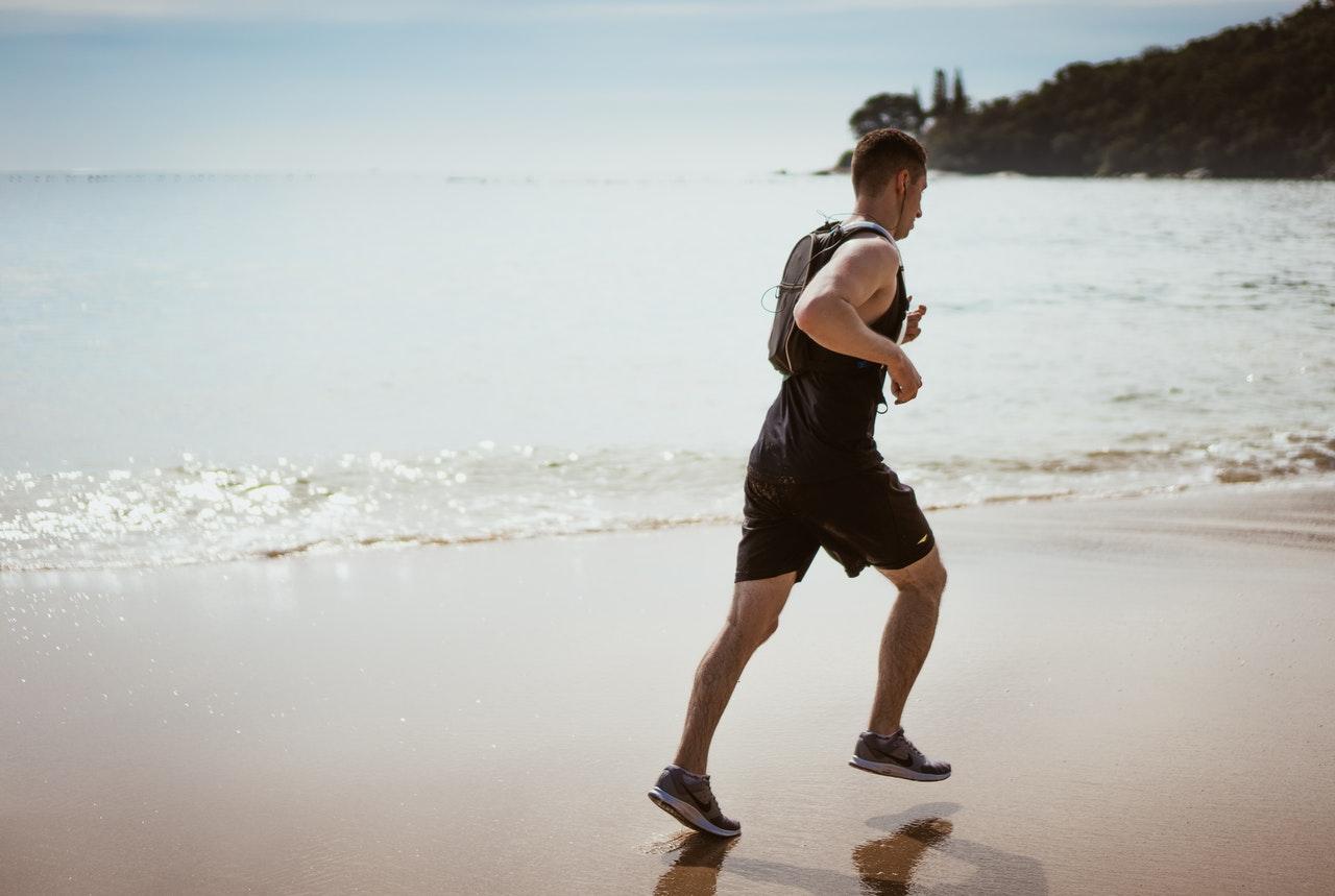 person running along the beach