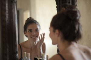 woman looking at herself in the mirror