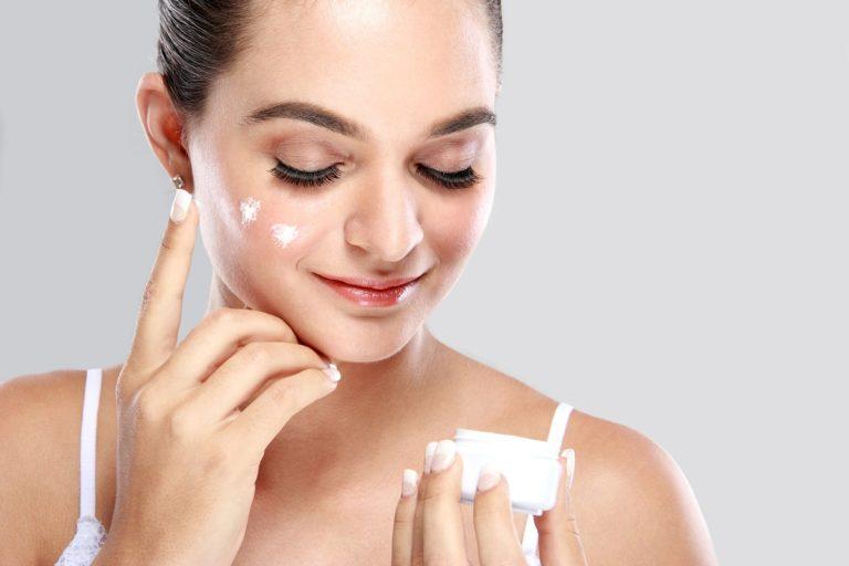 woman applying moisturiser