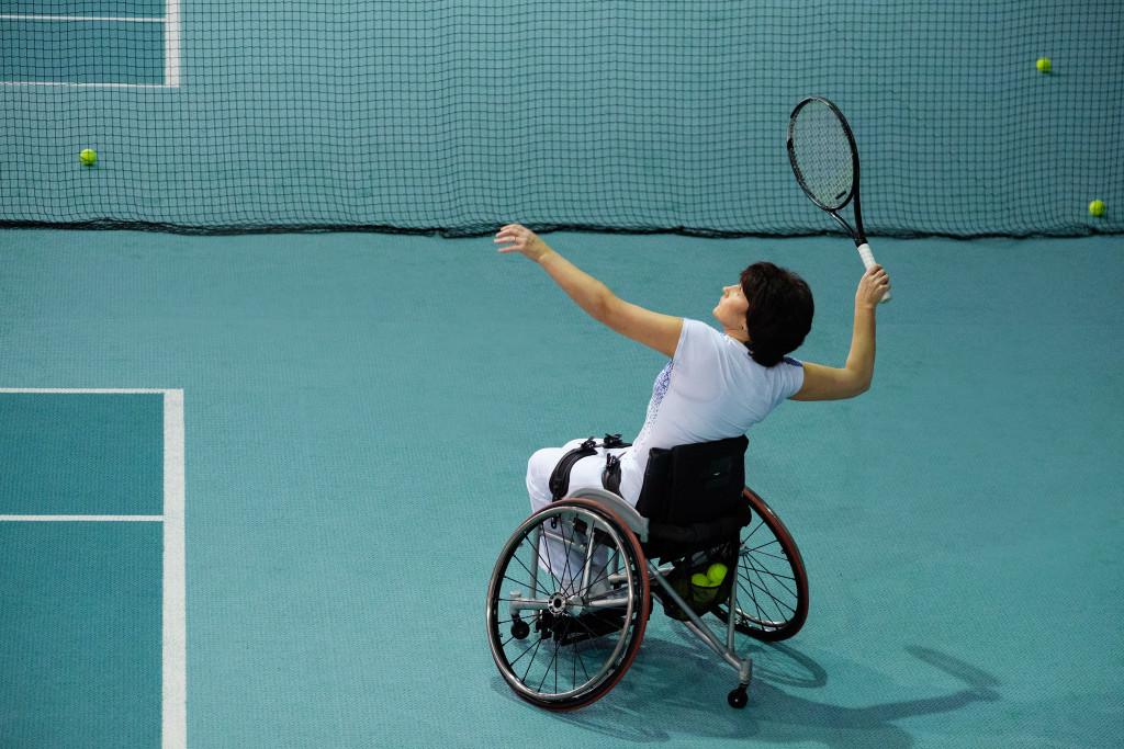 man on wheelchair playing tennis