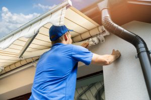 man fixing patio roof